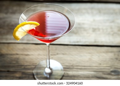 Cosmopolitan cocktail on the wooden background
