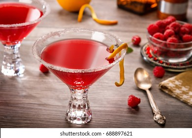 Cosmopolitan cocktails with raspberry dessert in a bar