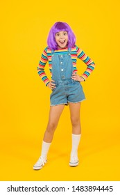 Cosplay outfit. Otaku girl in wig smiling on yellow background. Happy childhood. Anime fan. Cosplay kids party. Child cute cosplayer. Cosplay character concept. Culture hobby and entertainment.