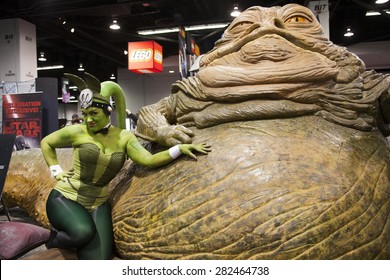 Cosplayer Chrissy Lynn poses with a statue of the character Jabba the Hut at the Star Wars Celebration in Anaheim California, April 2015.