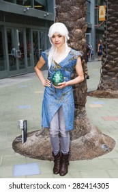 A cosplayer dressed as Daenerys Targaryen from the HBO show Game of Thrones at WonderCon in Anaheim, California, April 2014.