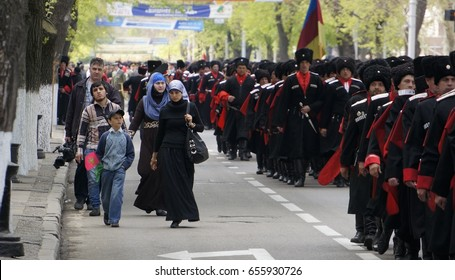 Cossacks marching along the main street of the city Adult men  in black Cherkessk and papakhs march along the city street.Representatives of the Adyghe people Krasnodar. South of Russia. 2013