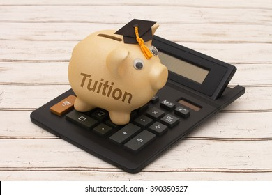 Cost of education, A golden piggy bank with grad cap and calculator on a wood background with text Tuition