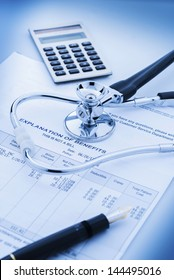 Cost of health care with stethoscope, calculator and pen