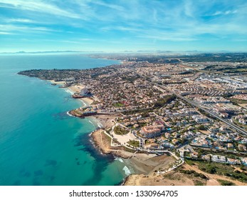 Costa Blanca view from above, drone point of view aerial photography. Turquoise green water rocky coastline, sandy beaches. Cityscape of Torrevieja, Orihuela Coast. Province of Alicante south of Spain