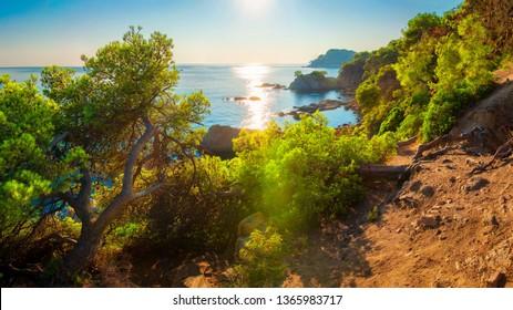 Costa Brava nature landscape on sea coast.  Picturesque view on sea spanish coastline. Scenic seascape on rocky bay in Lloret de Mar at sunset