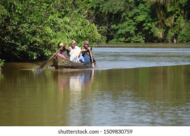Costa Caribe, Nicaragua, September 24, 2016: Great lake in which people are transported in a canoe and carrying a dog with them while they are crossing. Vacation concept.