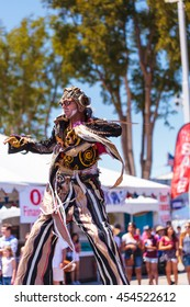 Costa Mesa, CA - July 16, 2016: Theatrical circus performer Derrick Gilday, part Mango and Dango, performs with Dragon Knights steampunk stilt walkers at the Orange County Fair in Costa Mesa, CA.