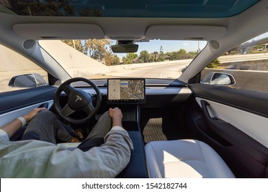Costa Mesa, CA / USA - 10/25/2019: Interior view of autonomous Tesla car in full self driving autopilot mode showing the advanced innovation of future electric cars.
