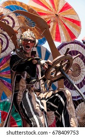 Costa Mesa, CA, USA - July 14, 2017: Theatrical circus performer Derrick Gilday performs with Dragon Knights steampunk stilt walkers at the Orange County Fair in Costa Mesa, CA. Editorial use only.