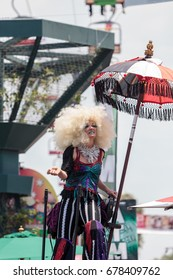 Costa Mesa, CA, USA - July 14, 2017: Theatrical circus performer Megan Fontaine performs with Dragon Knights steampunk stilt walkers at the Orange County Fair in Costa Mesa, CA. Editorial use only.