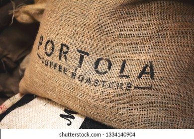 Costa Mesa, California/United States - 03/03/2019: A burlap sack filled with coffee beans with the coffee shop roastery known as Portola