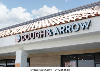 Costa Mesa, California/United States - 07/30/2019: A store front sign for the dessert shop known as Dough & Arrow