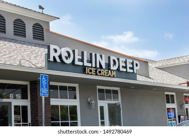 Costa Mesa, California/United States - 07/30/2019: A store front sign for the rolled ice cream shop known as Rollin Deep