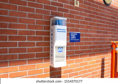 Costa Mesa, California/United States - 08/25/2019: An emergency telephone system on a brick wall of one of the building on a college campus