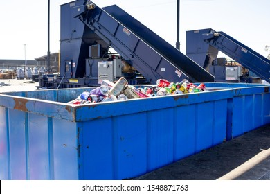 Costa Mesa, California/United States - 09/22/2019: A wide shot of sorting conveyor belt ramps that help sort the recycling material, located at OCC Recycling Center