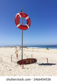 Costa Nova Beach, Costa Nova, Aveiro, Portugal, July 2019: Life guard post on the white sandy beach of Costa Nova, Aveiro district, Portugal.
