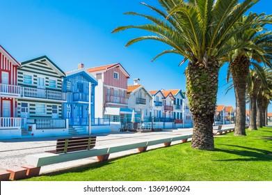 Costa Nova, Portugal: colorful striped houses called Palheiros with red, blue and green stripes. Costa Nova do Prado is a beach village resort on Atlantic coast near Aveiro.