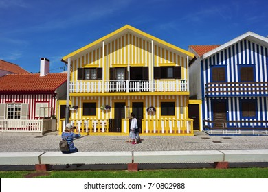 Costa Nova, Portugal - June 10, 2017: Street and residential houses in famous resort on the Atlantic coast near Aveiro. Popular tourist destination to spend vacation time