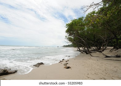 Costa Rica Tropical Beach and Coastline with Waves washing ashore