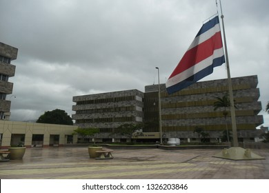 Costa Rican flag flying in the courtyard outside the Supreme Court of Justice in San Jose, Costa Rica