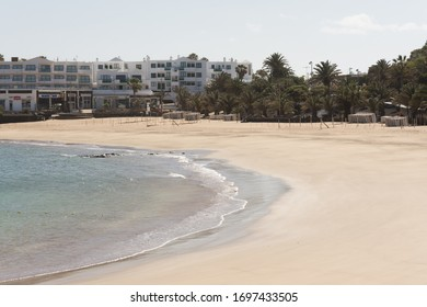 Costa Teguise, Canaries, Spain; 04.04.2020: Empty beach due to coronavirus lockdown. Hotels are closed. The future of tourism is uncertain.