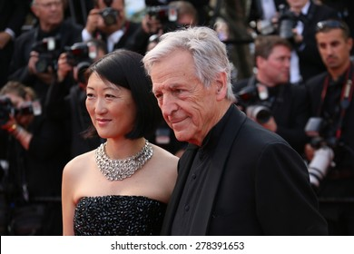 Costa-Gavras and Fleur Pellerin attend the opening ceremony and 'La Tete Haute' premiere during the 68th annual Cannes Film Festival on May 13, 2015 in Cannes, France.