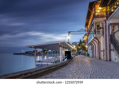 Costal street in old town of Nessebar at night