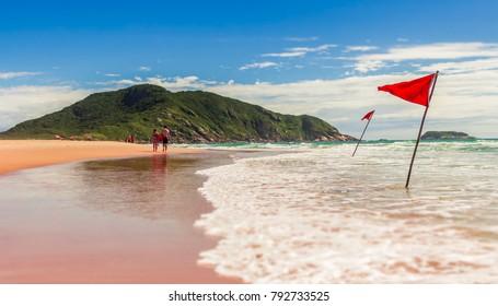 Costao do Santinho Beach with a Red Flag - Florianopolis