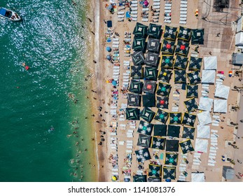 COSTINESTI, ROMANIA - JULY 15, 2018: Aerial View From Flying Drone Of People Crowd Relaxing On Costinesti Beach In Romania