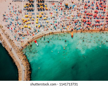 COSTINESTI, ROMANIA - JULY 16, 2018: Aerial Drone View Of People Crowd Having Fun And Relaxing On Costinesti Beach In Romania