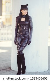 Costume of a beautiful young model wearing a cat costume. Hot sexy brunette cat-style female black fetish latex leather cat. Halloween.