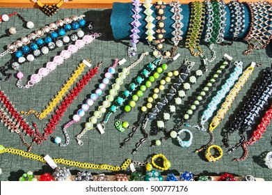 Costume jewelery and beads exposed for sale.