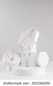 costume jewelry on white geometric figures earrings, chain on a white background - Shutterstock ID 2015361050