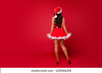 Costume party concept. Full length, legs, body, size back behind rear view brunette lady on sharp, pumps, stilettos lady with curly wave modern hairstyle isolated on shine red background