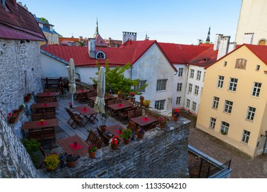 Cosy cafe on the roof of old town in the courtyard. Tallinn, Estonia.