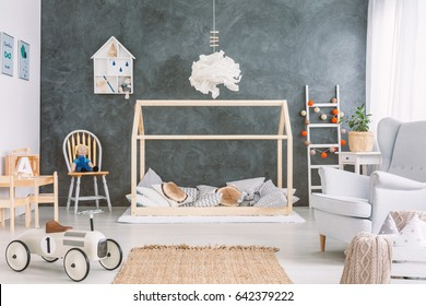 Cosy childs room with many toys and grey wall