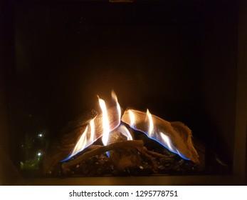 Cosy indoor fireplace in livingroom