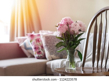 Cosy living room with flowers and sunset