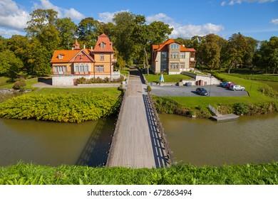 Cosy old wooden houses (luxury hotels) near Kuressaare castle. A view of Saaremaa island, Estonia.