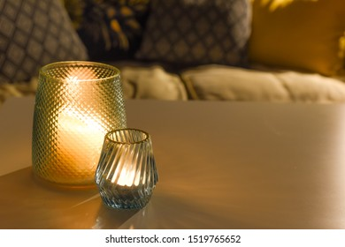 Cosy room interior inside a family home living room with candle light
