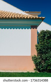 Cosy traditional old facade of mediterranean house pink paint - great for a book cover