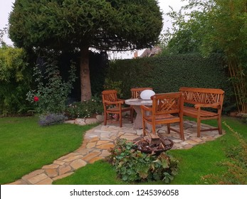 Cosy wooden sitting area in the garden