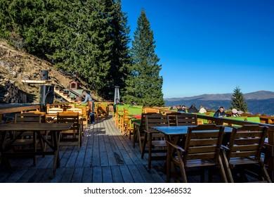 "COTA 1400, SINAIA, ROMANIA - NOVEMBER 8, 2018. ""La Ceaunu' Crapat"" , traditional Romanian restaurant at 1400m in Bucegi mountains , near Gondola Carp and Teleferic , Sinaia Resort, Romania."