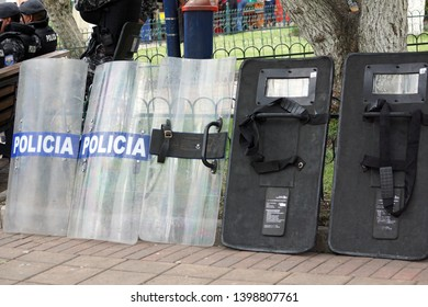 """COTACACHI, ECUADOR - CIRCA JUNE 2016: Police riot shields (""""police"""") in the square for Inti Raymi, the solstice festival, with a history of violence in the village"""
