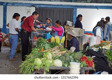 COTACACHI, ECUADOR - DECEMBER 5, 2014: Vendors and people shopping in the weekly market