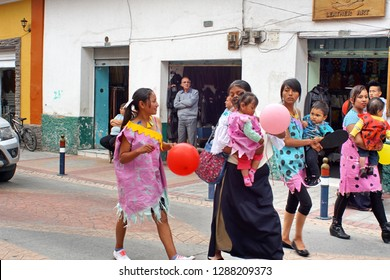 COTACACHI, ECUADOR - FEBRUARY 4, 2016: Families in Flintstones costumes in the Carnival parade