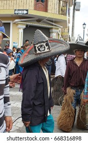 COTACACHI, ECUADOR - JULY 24, 2017: Men's parade in Inti Raymi, the indigenous solstice celebration, with a history of violence in the village