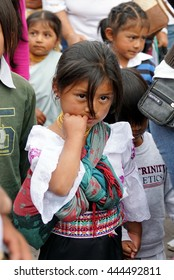 COTACACHI, ECUADOR - JUNE 22, 2016:  Children's parade for Inti Raymi, the Quechua Festival of the Sun.  Young girl in traditional dress.