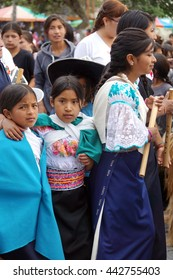 COTACACHI, ECUADOR - JUNE 23, 2016: Children's parade in Inti Raymi, the solstice celebration.  Young women are in traditional dress.